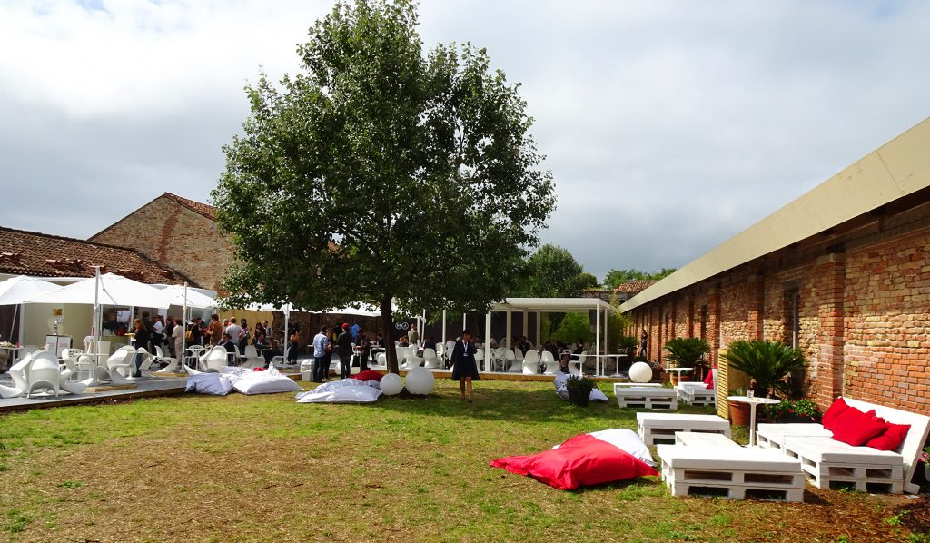 The busy courtyard of the Lazzaretto Vecchio, a medieval hospital and stage for La Biennale's Venice VR.